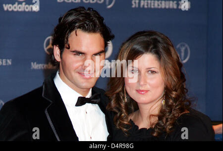 (dpa file) A file picture 18 February 2008 captures Swiss tennis champion Roger Federer (L) and his wife Mirka Vavrinec - Stock Photo