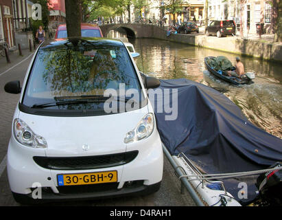 A Smart car is parked nect to a canal in Amsterdam, Netherlands, 28 July 2009. According to a report of the Dutch - Stock Photo
