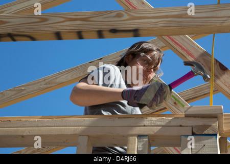 Rebuilding Home for Hurricane Katrina Victim - Stock Photo