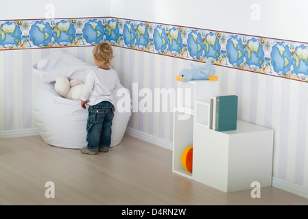 Baby boy playing in nursery - Stock Photo