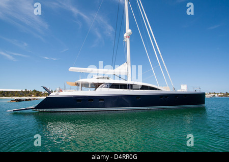 A large catamaran on the dock in the Bahamas. - Stock Photo