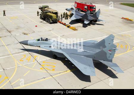 Pair of Serbian Air Force MiG-29 aircraft parked at Graf Ignatievo Air Base, Bulgaria. - Stock Photo