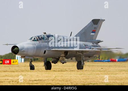 A Serbian Air Force MiG-21UM taxiing at Batajnica Air Base, Serbia. - Stock Photo