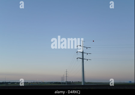 Dawn view pylons carrying electricity cables over prairie landscape, south from Little America Resort, Cheyenne, - Stock Photo