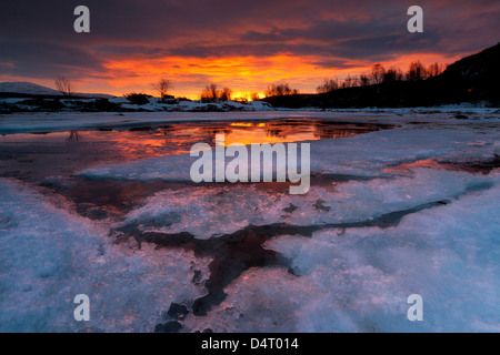 A fiery sunrise over Lavangsfjord, Troms, Norway. - Stock Photo