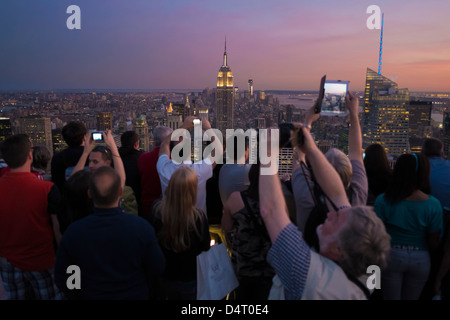 Tourists taking pictures at Rockefeller Center Observatory, New York, USA - Stock Photo