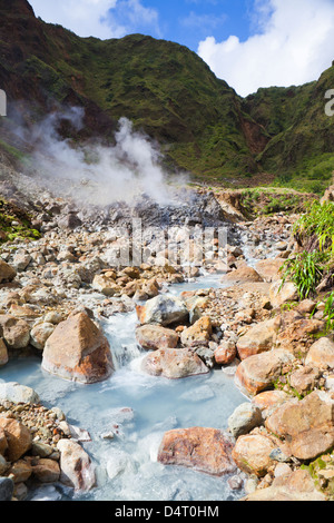 The Valley of Desolation - sulphurous fumaroles on the Boiling Lake hike in Dominica - Stock Photo