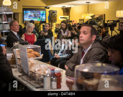 NY Mayor Michael Bloomberg, left, speaks at a press conference in Lucky's Restaurant in New York - Stock Photo