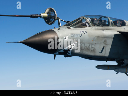 An Italian Air Force Tornado IDS conducts in-flight refueling. - Stock Photo