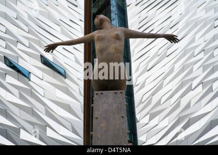 Rowan Gillespie's sculpture Titanica in front of the Titanic museum in Belfast. - Stock Photo