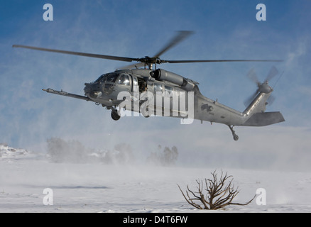 An HH-60G Pave Hawk fly's low over a landing zone in New Mexico. - Stock Photo