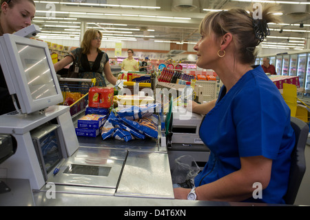 Colmar, France, a cashier in a supermarket Leclerc - Stock Photo