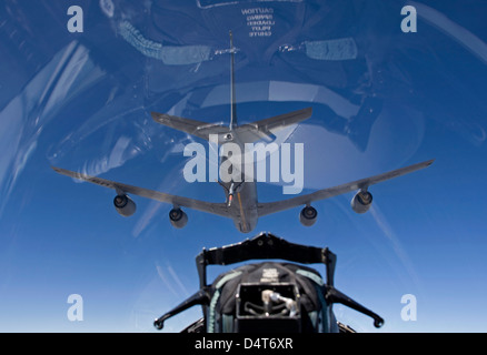 An F-15 Eagle pulls into pre-contact position behind a KC-135 Stratotanker during a training mission. - Stock Photo