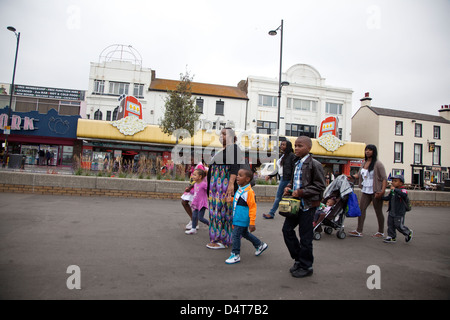 Southend, UK, immigrant family on the beach promenade - Stock Photo