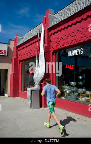 Jogger running past antique shop on Beverly Blvd. in Los Angeles - Stock Photo
