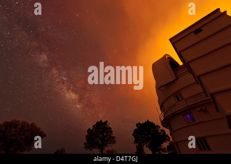 Milky Way appears through smoke over the McDonald Observatory. - Stock Photo