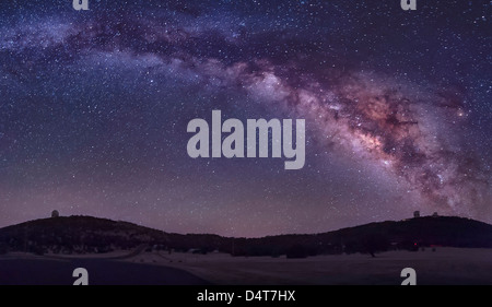 The summer Milky Way rises over the McDonald Observatory near Fort Davis, Texas. - Stock Photo