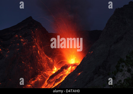 Strombolian type eruption of Batu Tara volcano, Indonesia. - Stock Photo