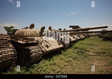 Russian T-62 main battle tanks rest in an armor junkyard in Kunduz, Afghanistan. - Stock Photo