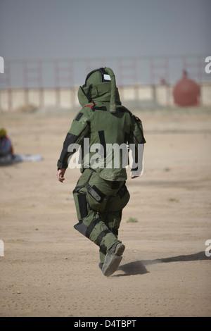 Kunduz, Afghanistan - A U.S. Marine tries running in a German Army EOD blast suit. - Stock Photo