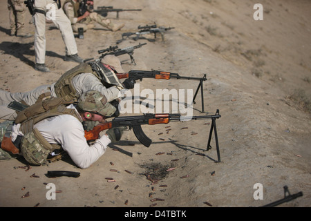 U.S. Navy EOD soldiers fire a Russian 7.62x39mm RPK Kalashnikov Light Machine Gun on the firing range in Kunduz, - Stock Photo