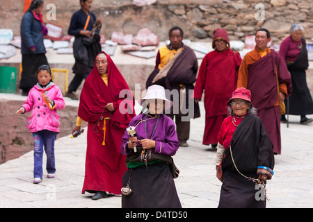 Tibetan Buddhist praying around the Dêgê Tibetan lamasery in Kham area, Sichuan province of China - Stock Photo