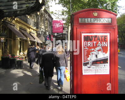A red telephone booth at a well attended business road in London, United Kingdom, 26 October 2009. Photo: Johannes - Stock Photo