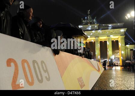 Illuminating Brandenburg Gate in Berlin, Germany, 09 November 2009 during celebrations marking the 20th anniversary - Stock Photo