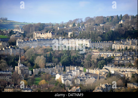 View across the rooftops of Bath including Camden Crescent and Lansdown Woods (top) Somerset UK - Stock Photo