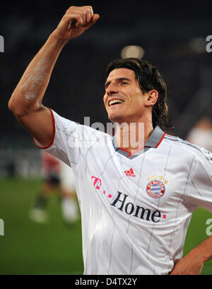 Munich's Mario Gomez cheers after scoring a goal bringing Munich in the lead 3-0 during the German Bundesliga match - Stock Photo