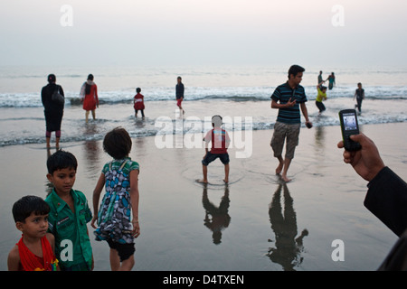 Bangladeshi visitors tourists on the beach in Cox's Bazar, Bangladesh - Stock Photo
