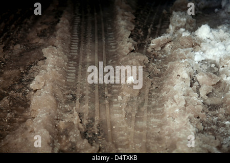 Close up of tire tracks in snow slush - Stock Photo