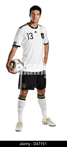 An undated adidas handout Germany skipper Michael Ballack posing with Jabulani, the official ball for the FIFA 2010 - Stock Photo