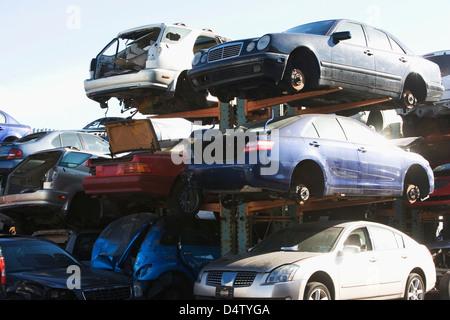 Cars sitting in junkyard - Stock Photo