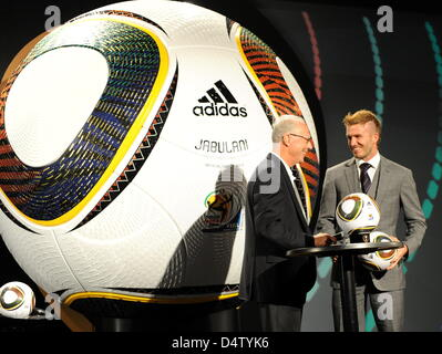 German soccer legend Franz Beckenbauer (L), president of the 2006 FIFA World Cup Germany, chats with England international - Stock Photo