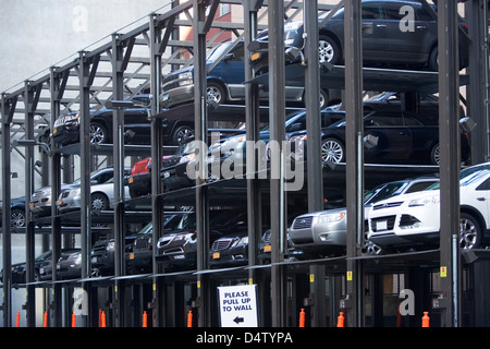 Cars in parking structure - Stock Photo
