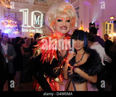 Chinese actress Bai Ling (R) and Drag Queen Olivia Jones celebrate during the 'Movie meets Media' gala in Hamburg, - Stock Photo