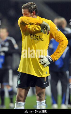 Bremen's goalkeeper Tim Wiese is disappointed after the German Bundesliga match Schalke 04 vs Werder Bremen at Weserstadium - Stock Photo