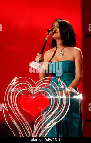 Mexican actress Salma Hayek receives the Golden Heart award for her worldwide engagement against poverty during - Stock Photo