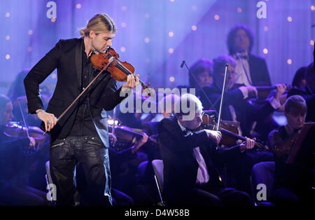 German star violinist David Garrett (C) performs during dress rehearsal of 15th Jose Carreras Gala in Leipzig, Germany, - Stock Photo