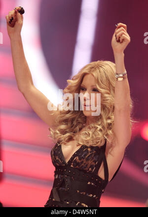 Sylvie van der Vaart, jury member of casting show 'The Supertalent', dance during a commercial break at the finale - Stock Photo