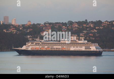 Cruise Ship Amsterdam passing through Sydney Harbour in the early morning - Stock Photo
