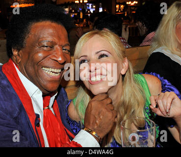 Entertainer and singer Roberto Blanco and his girlfriend Luzandra Strassburg celebrate at the Wiesn-meeting of the - Stock Photo