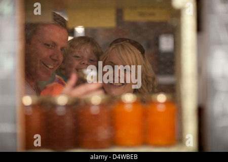 Family shopping for jam in grocery - Stock Photo