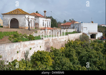 Abounded farm building with citrus orchard on road 124 at Falocha Algarve Portugal Europe early March 2013 - Stock Photo