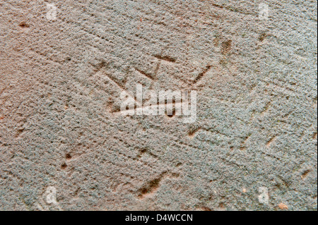 Masons mark on the sandstone of 15th century Silves Cathedral in the Algarve region of southern Portugal Europe - Stock Photo