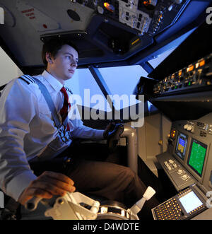 A pilot sits in a simulator cockpit of a Boeing 737 in Munich, Germany, 24 November 2010. Fans ov civil aviation - Stock Photo