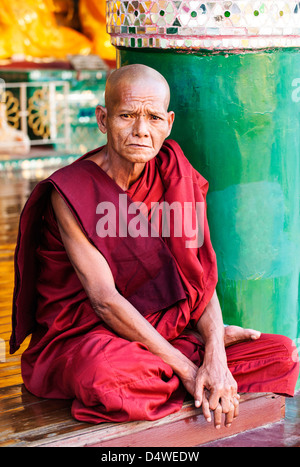 A Buddhist monk in Shwedagon Pagoda, Yangon, Burma (Myanmar) - Stock Photo
