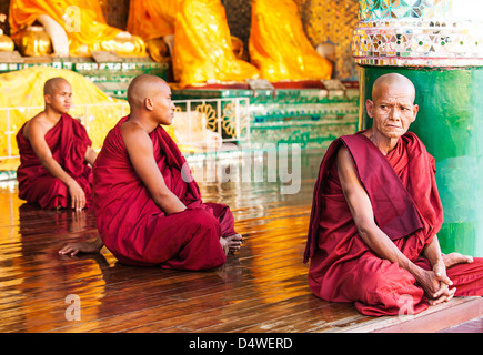 Buddhist monks in Shwedagon Pagoda, Yangon, Burma (Myanmar) - Stock Photo