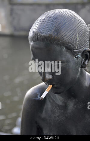 ILLUSTRATION - A file picture dated 19 September 2012 shows a fuming cigarette in the mouth of one of the sculptures - Stock Photo